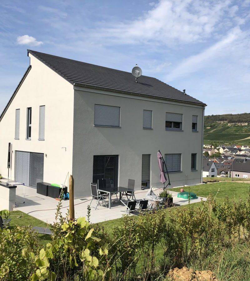 Einfamilienhaus großem Garten bietet Wohnkomfort auf drei Ebenen